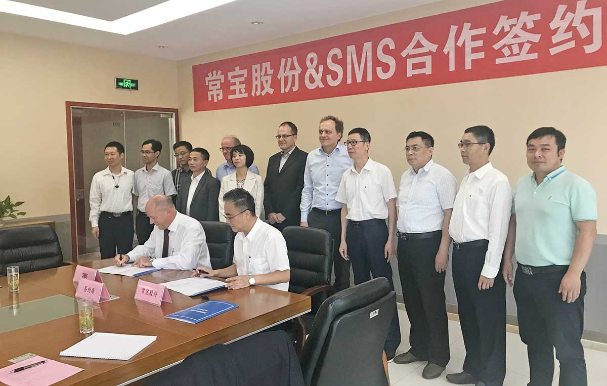 The ChangBao and SMS group project teams during contract signing ceremony.